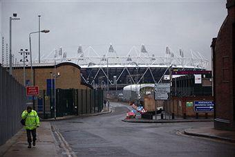 Olympic_Stadium_behind_buildings_January_25_2011