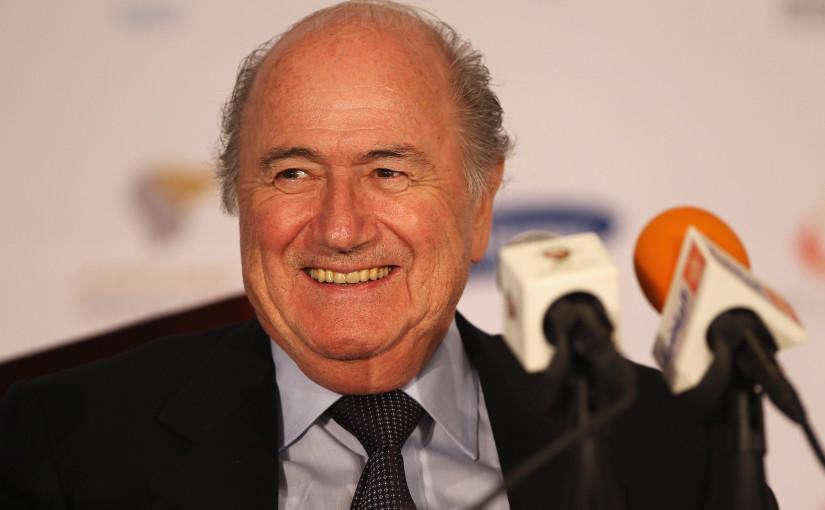Sepp_Blatter_smiling_behind_microphone