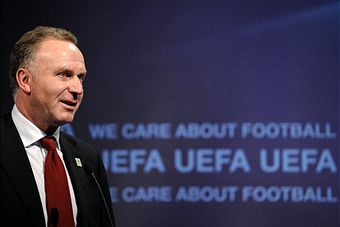 Karl-Heinz_Rummenigge_in_front_of_UEFA_logo