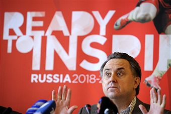 Vitaly_Mutko_in_front_of_Russian_2018_logo_December_2010