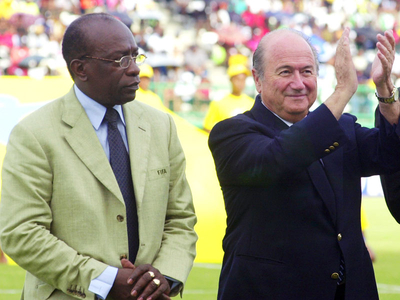 Sepp Blatter_with_Jack_Warner_acknowledging_the_crowd