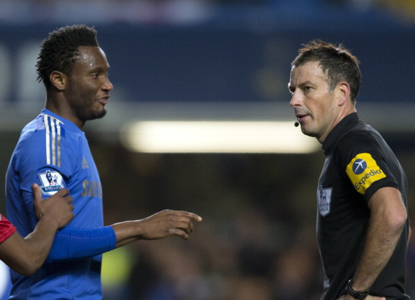 John Mikel_Obi_2nd_R_talking_with_referee_Mark_Clattenburg_16-11-12
